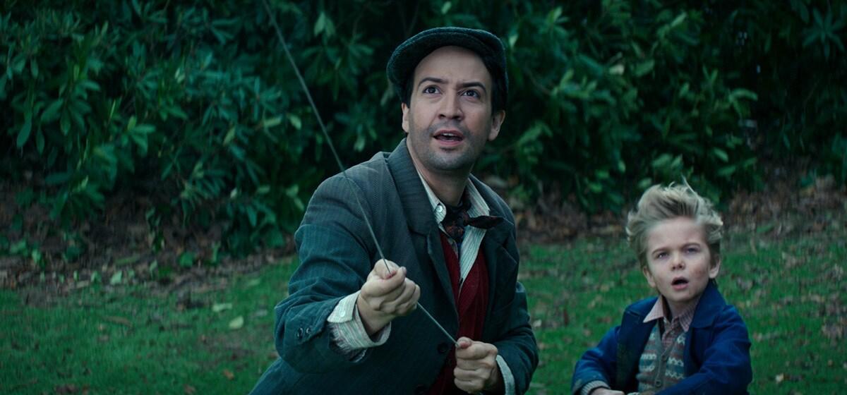 "Lin-Manuel Miranda (Jack) and Joel Dawson (Georgie) flying a kite in ""Mary Poppins Returns"""