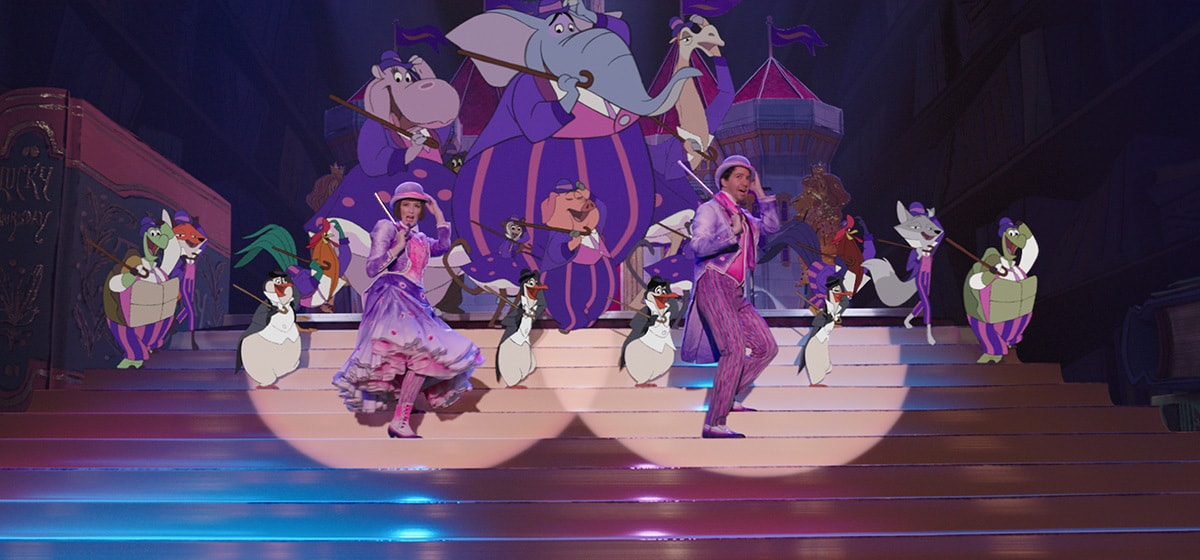 """Lin-Manuel Miranda(Jack) and Emily Blunt (Mary Poppins) dancing with animated characters in """"Mary Poppins Returns"""""""