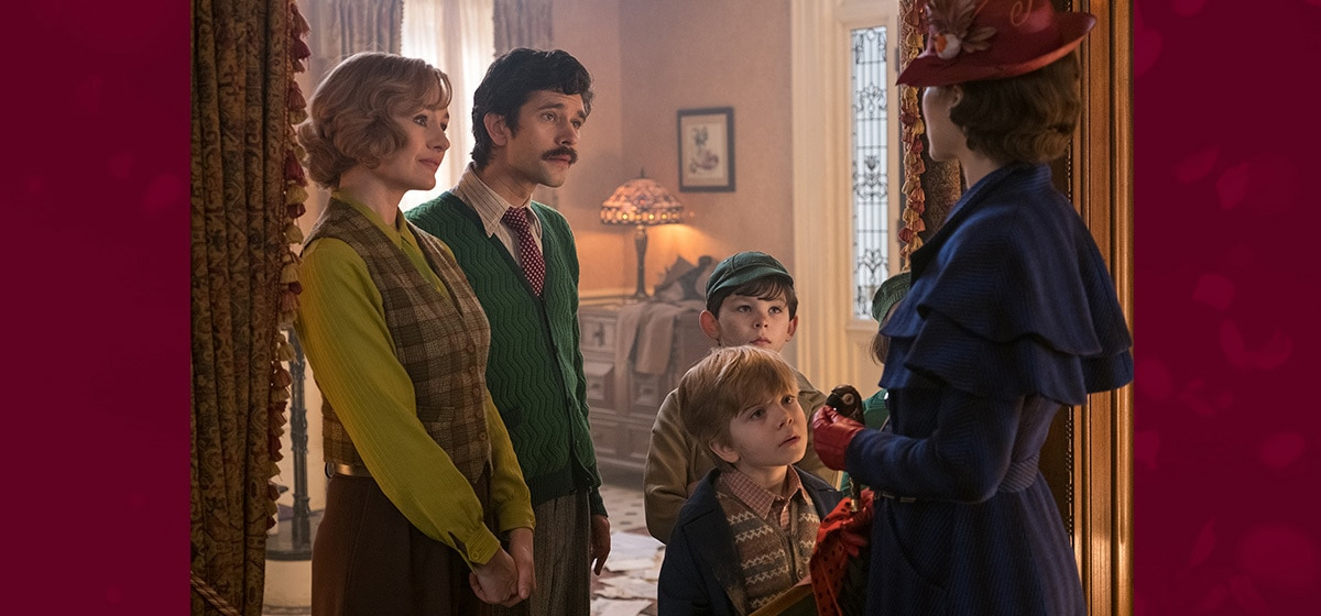 """The Banks family standing in a doorway with Mary Poppins in """"Mary Poppins Returns"""""""
