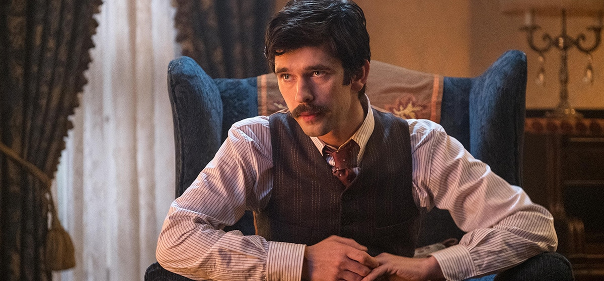 """Ben Whishaw (Michael) seated in a chair in """"Mary Poppins Returns"""""""