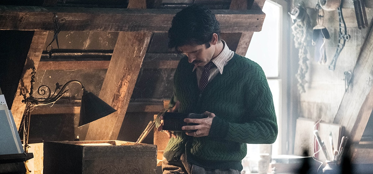 """Ben Whishaw (Michael) standing in the attic with a small box in his hand in """"Mary Poppins Returns"""""""