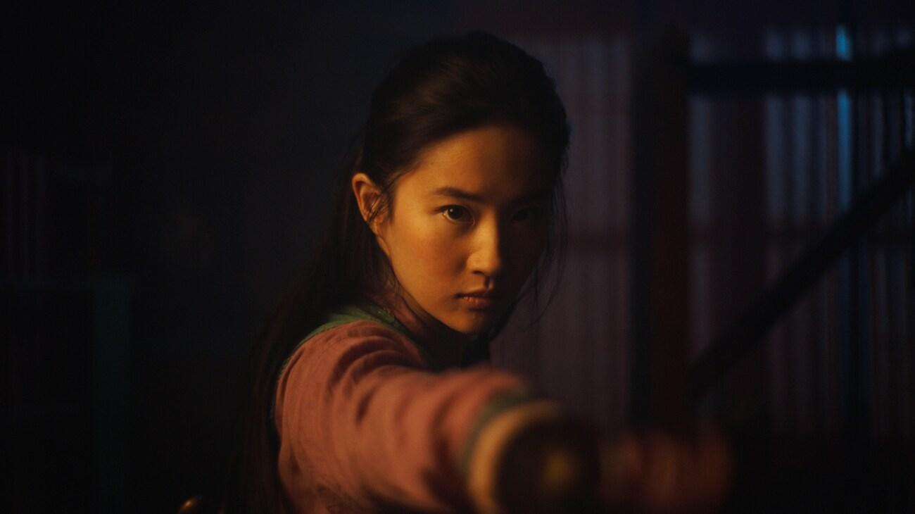 "Yifei Liu (Mulan) with a sword in ""Mulan"""
