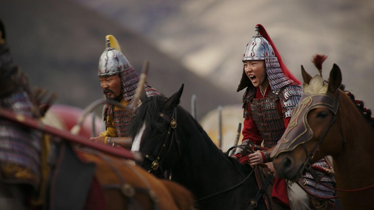 """Yifei Liu (Mulan) dressed as a soldier on horseback in """"Mulan"""""""