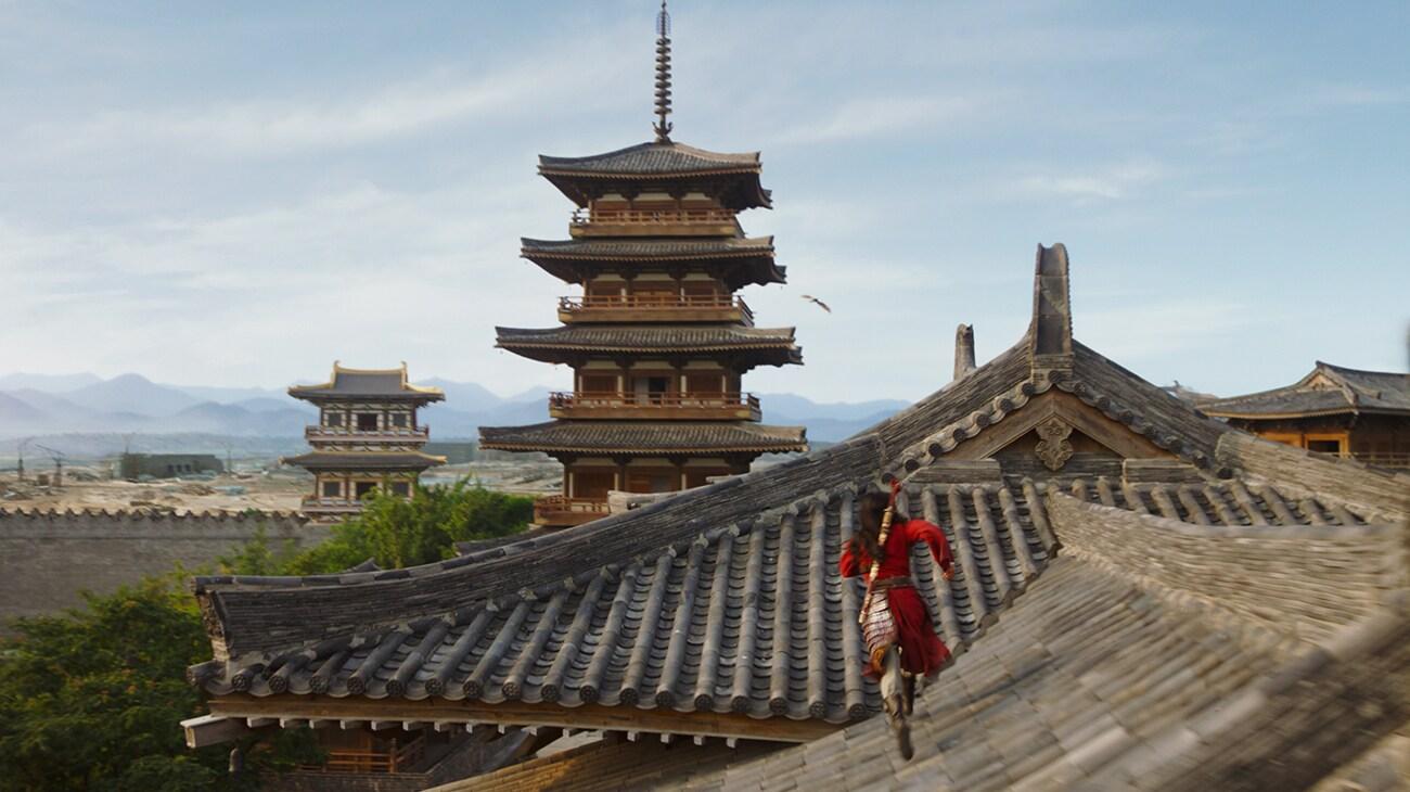 "Yifei Liu (Mulan) running across rooftops in ""Mulan"""