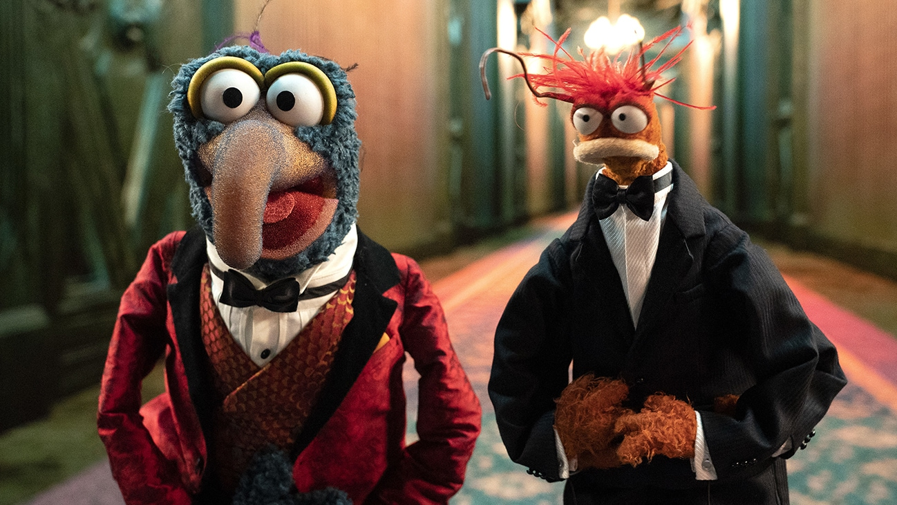 Image of Gonzo dressed in a bow tie and jacket and Pepe the King Prawn dressed in a tuxedo from the Disney movie Muppets Haunted Mansion. (Disney/Mitch Haaseth)
