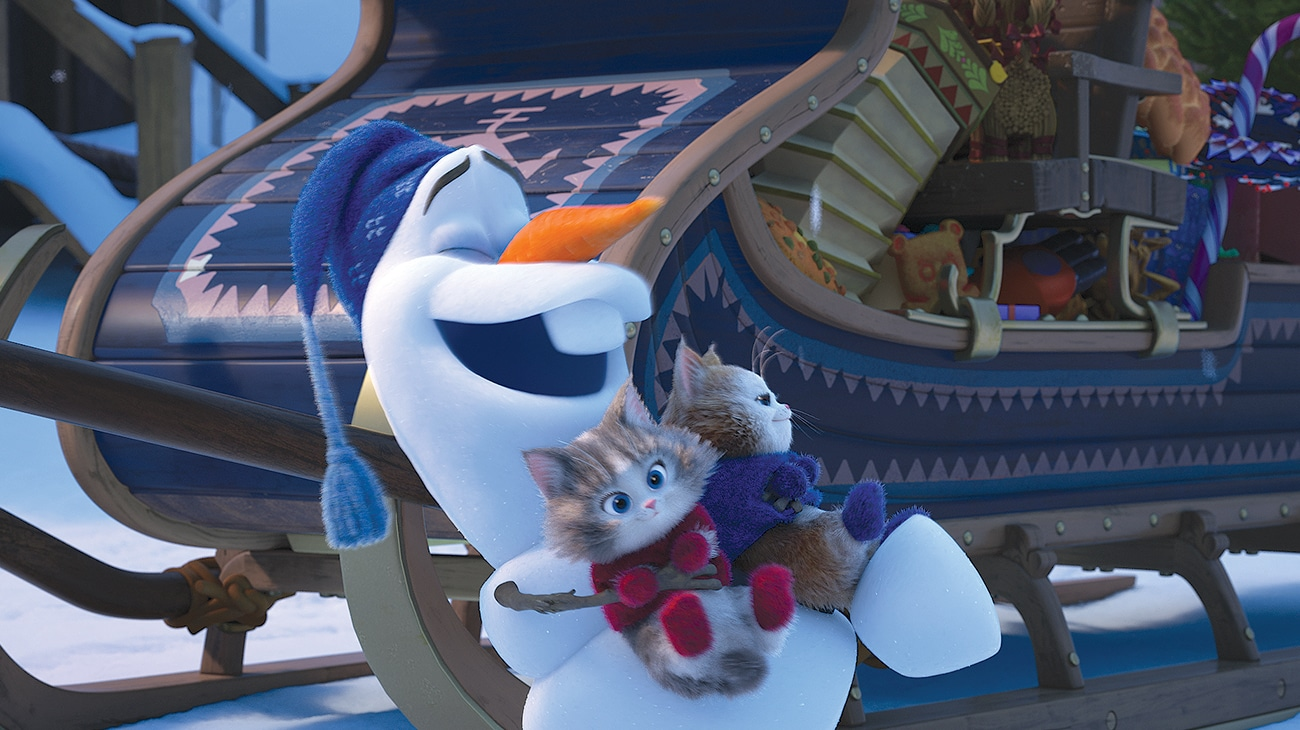 """Olaf holding two kittens in """"Olaf's Frozen Adventure"""""""