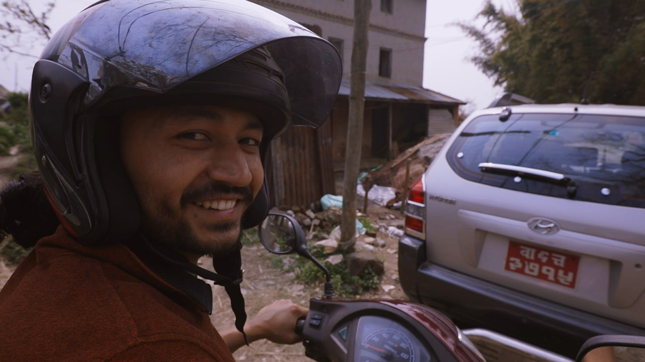 Bhaktapur, Nepal - Santosh Pandey rides a motorcycle through his hometown of Bhaktapur, Nepa. (Credit: Future of Work Film Inc)