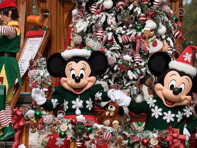 Mickey Mouse and Minnie Mouse greet fans