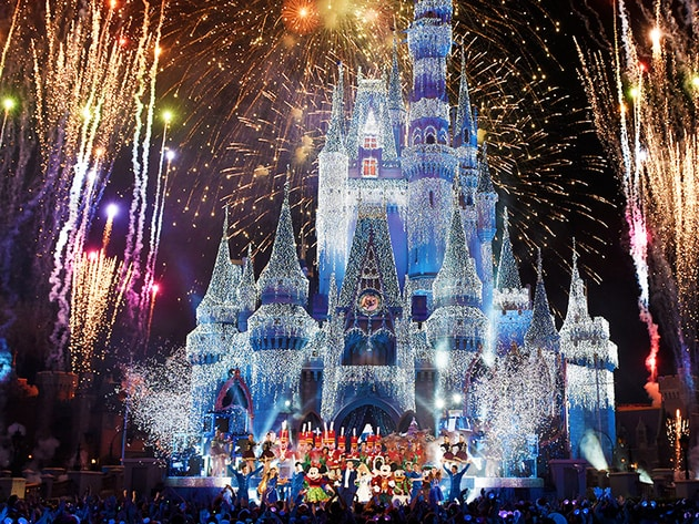 Fireworks light up the sky behind Cinderella Castle at the Magic Kingdom
