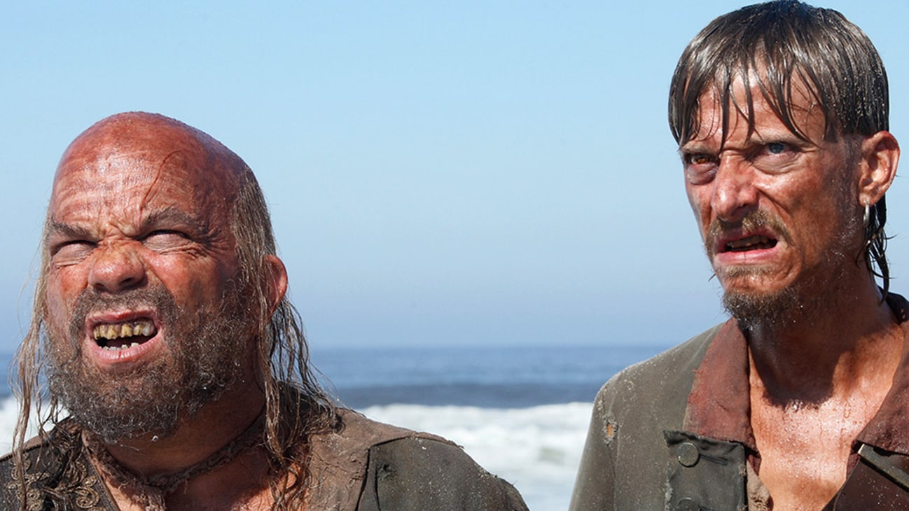 Pintel (Lee Arenberg) and Ragetti (Mackenzie Crook) in the Disney movie Pirates of the Caribbean: At World's End.