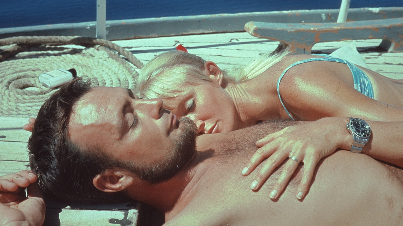 Valerie & Ron Taylor sunbathing together on a boat deck in 1967. (photo credit: Ron & Valerie Taylor)