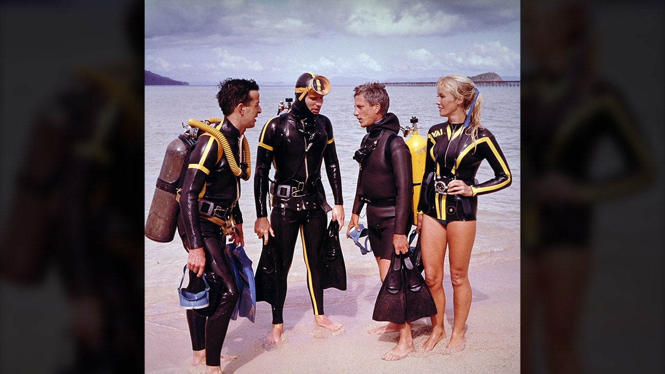 Valerie Taylor with friends in scuba equipment on the beach in 1968. (photo credit: Ron & Valerie Taylor)