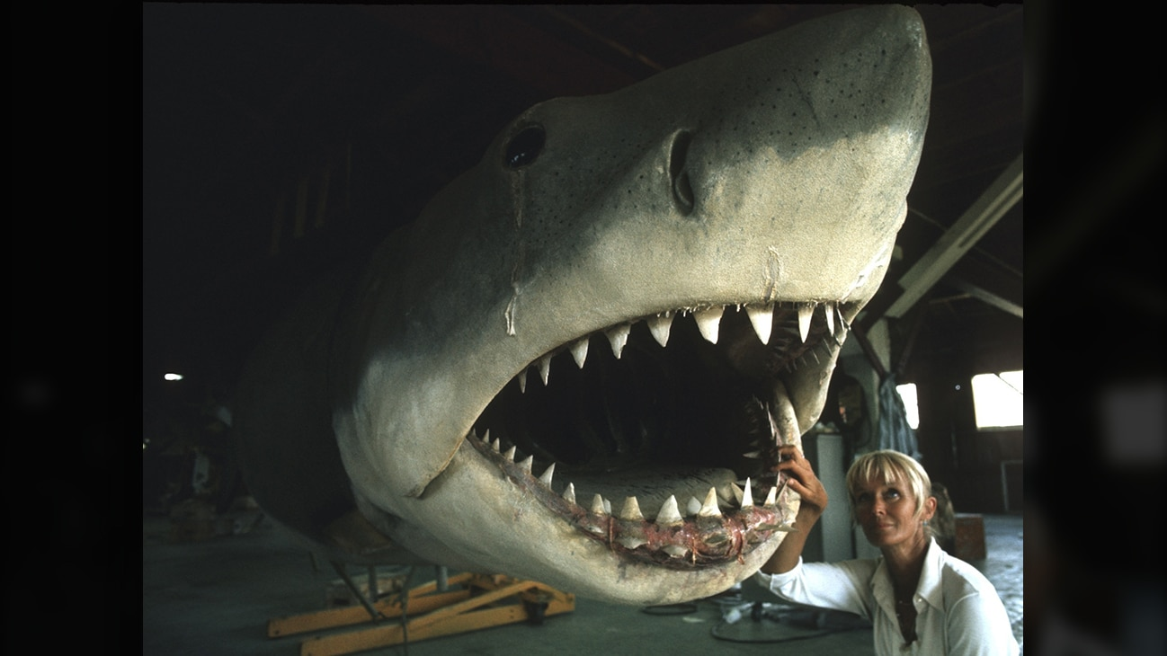 Valerie Taylor on the Jaws film set standing next to a shark prop in 1974. (photo credit: Ron & Valerie Taylor)