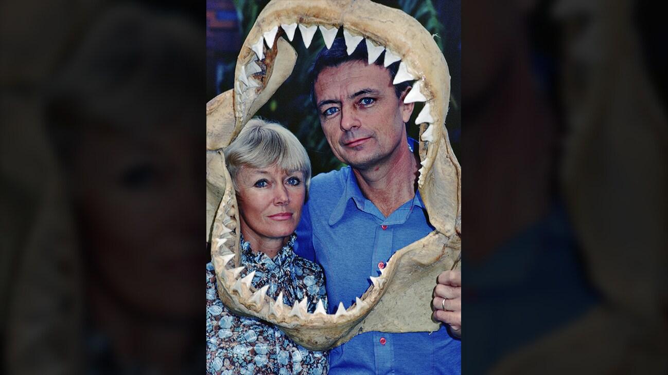 Ron & Valerie Taylor framed by a shark jaw skeleton. (photo credit: Ron & Valerie Taylor)