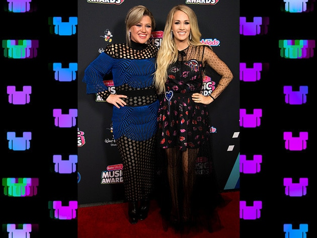2018 RDMA Icon Award honoree Kelly Clarkson & Hero Award honoree Carrie Underwood share an Americ...