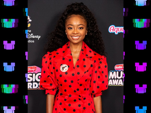 Skai Jackson wearing red for the RDMA red carpet