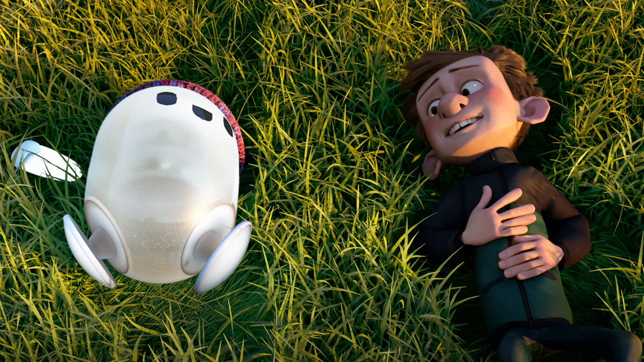 Image of Ron and Barney lying on the grass from the 20th Century Studios movie Ron's Gone Wrong.