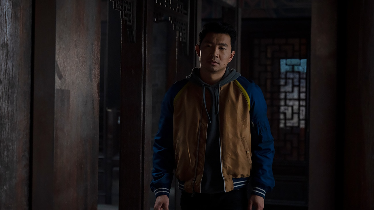 Shang-Chi (Simu Liu) stares off into the distance from the Marvel Studios movie Shang-Chi and The Legend of the Ten Rings.
