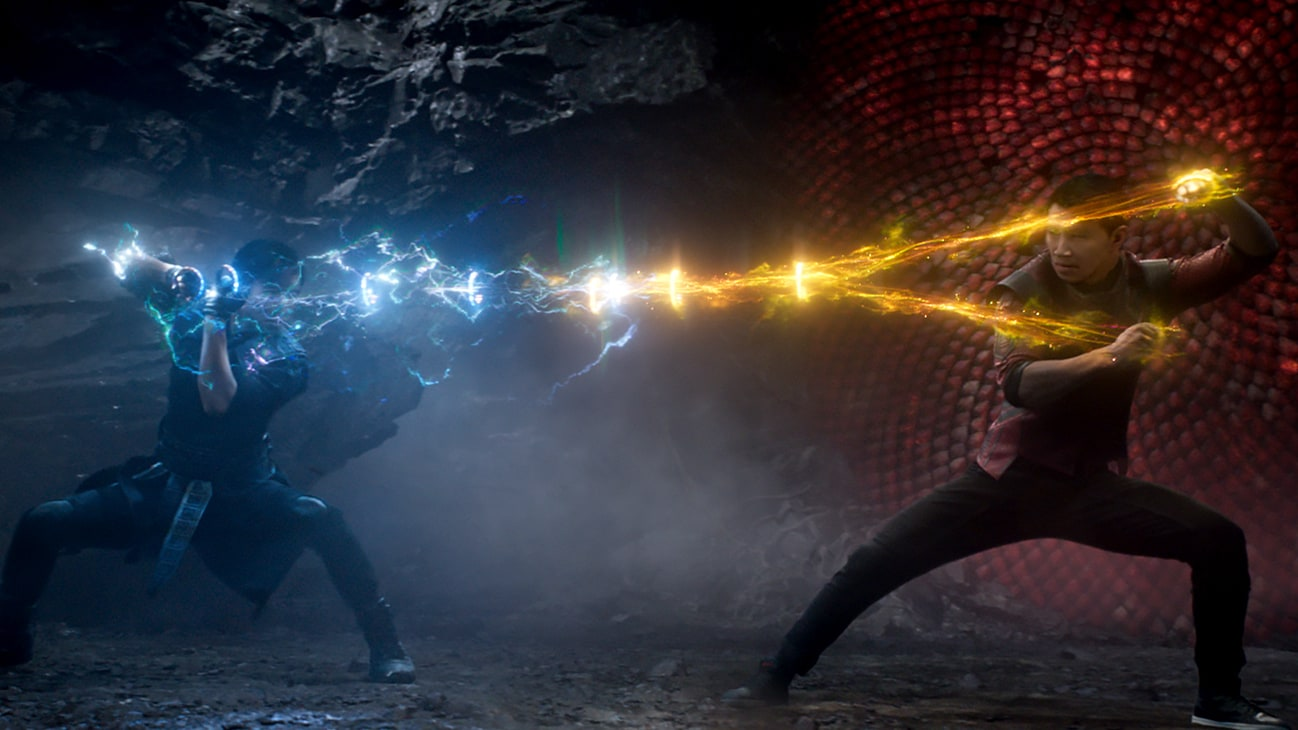 A battle between two people aiming at each other with coloured lightning from Marvel Studios' Shang-Chi and The Legend of the Ten Rings.