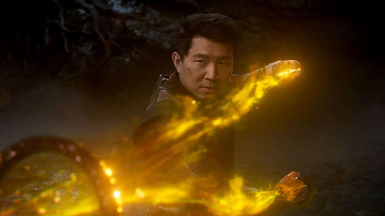 Shang-Chi (Simu Liu) shoots lightning from his hands from Marvel Studios' Shang-Chi and The Legend of the Ten Rings.