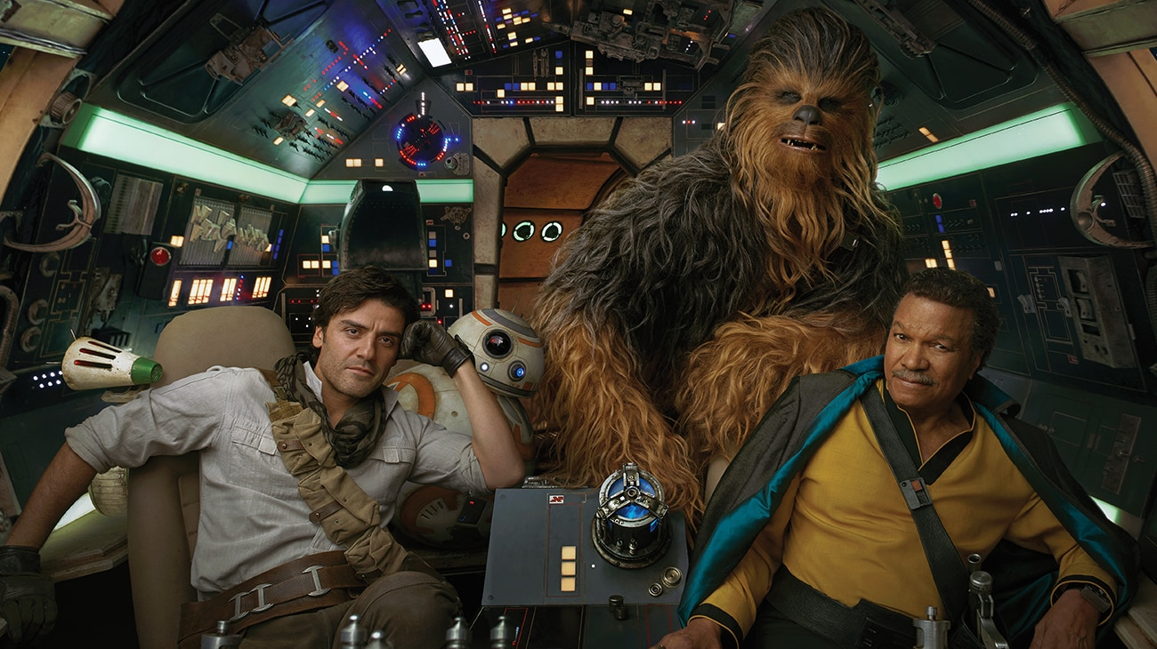 """Oscar Isaac as Poe Dameron, Billy Dee Williams as Lando Calrissian, Joonas Suotamo as Chewbacca, and BB-8 in the cockpit of the Millennium Falcon in """"Star Wars: The Rise of Skywalker"""""""