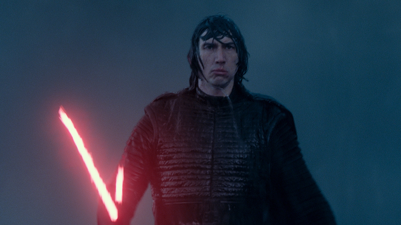 """Adam Driver as Kylo Ren, wet and holding his red glowing light saber in """"Star Wars: The Rise of Skywalker"""""""