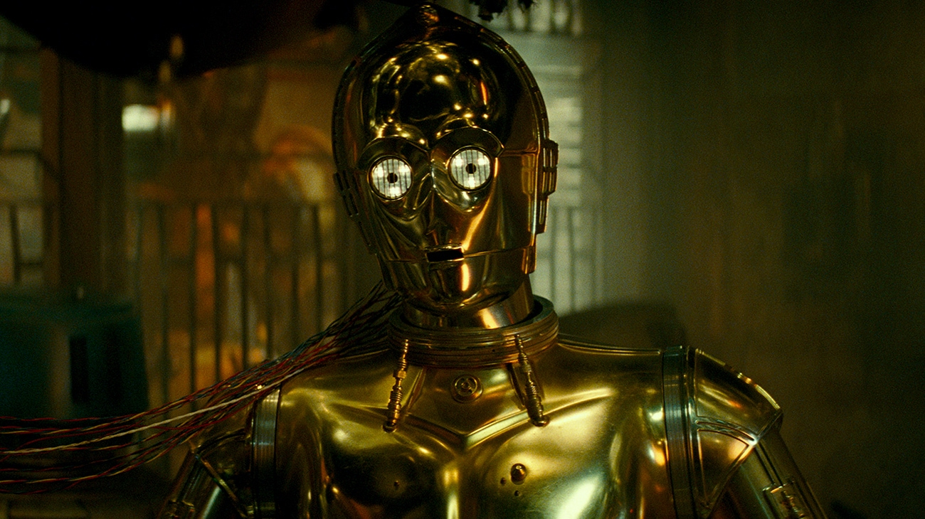 """Zoomed in shot of the bust of C3P-O played by Anthony Daniels in """"Star Wars: The Rise of Skywalker"""""""