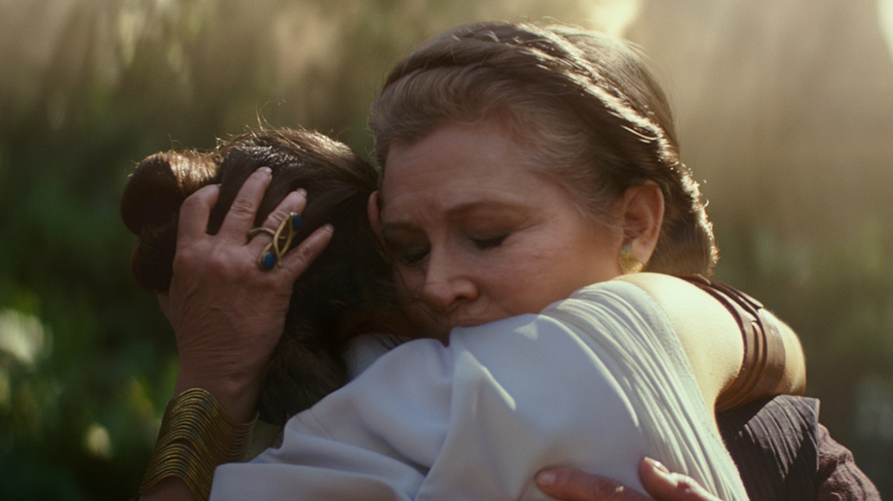 """Carrie Fisher as Leia Organa hugging Daisy Ridley as Rey in """"Star Wars: The Rise of Skywalker"""""""