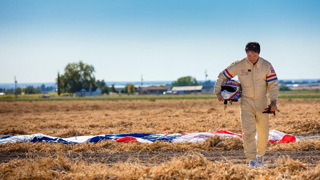 Image of Eddie Braun walking away from a parachute with his helmet in his hand from the Disney+ Originals movie Stuntman. (Disney/ Steve Dondero)