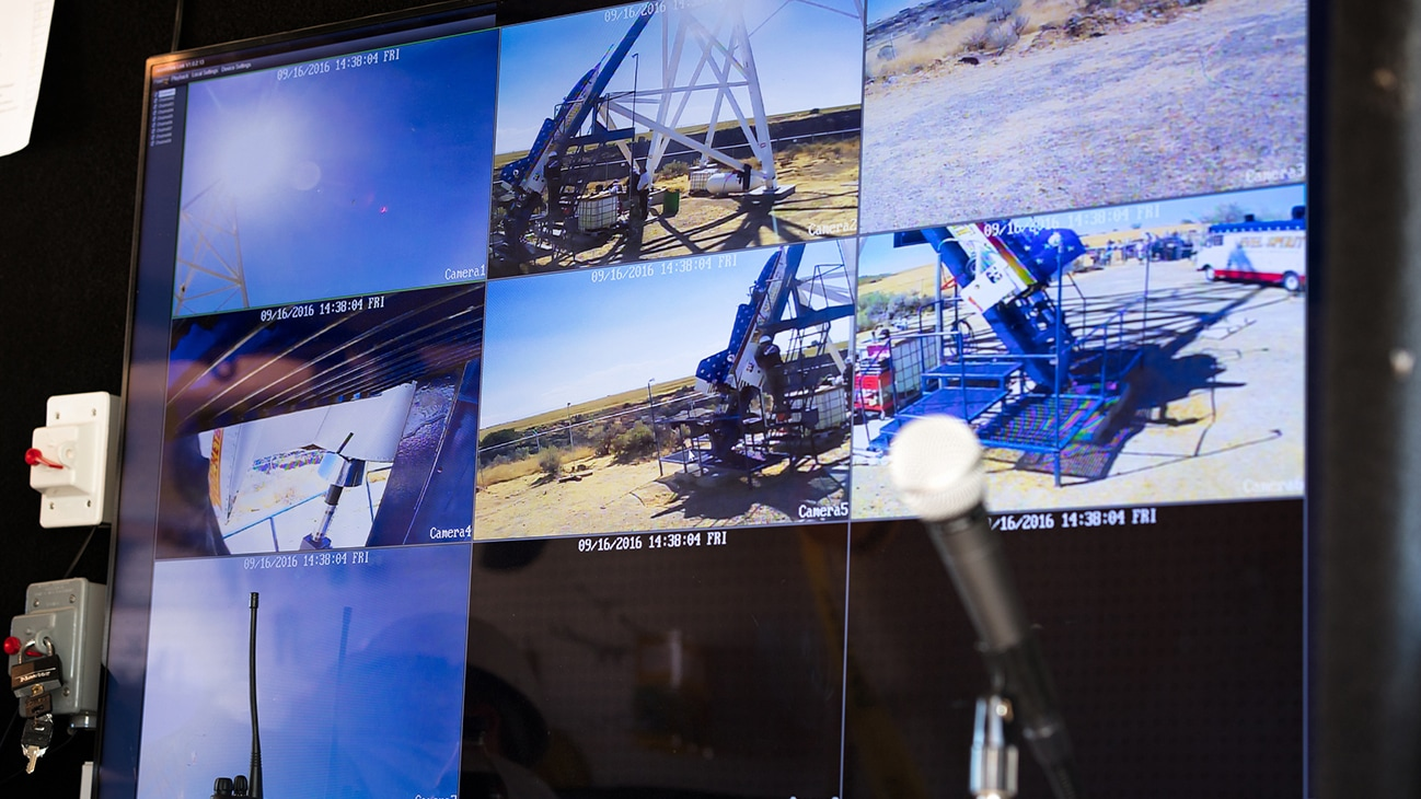 Image of nine TV screens showing different angles of the rocket launch pad from the Disney movie Stuntman. (Disney/ Steve Dondero)