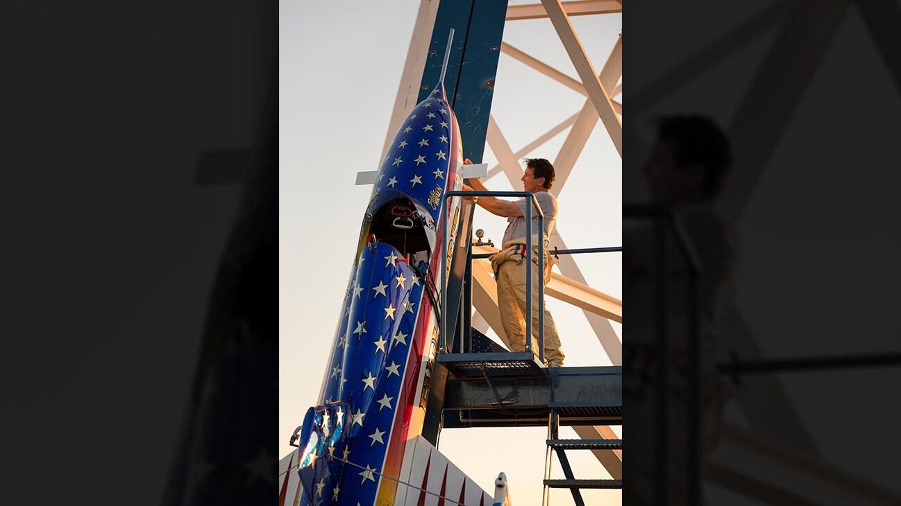 Picture of Eddie Braun inspecting a rocket on a launch pad from the Disney+ Originals movie Stuntman. (Disney/ Steve Dondero)