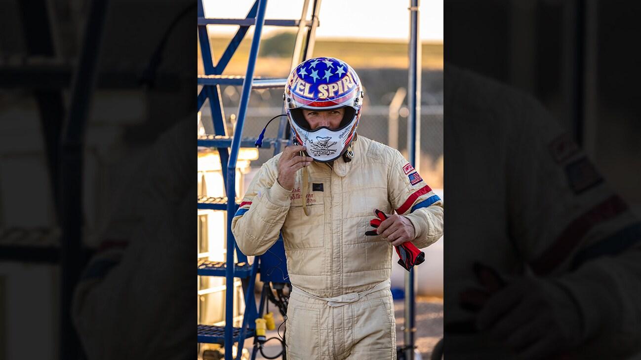 Picture of Eddie Braun in racing uniform and helmet from the Disney+ Originals movie Stuntman. (Disney/ Steve Dondero)