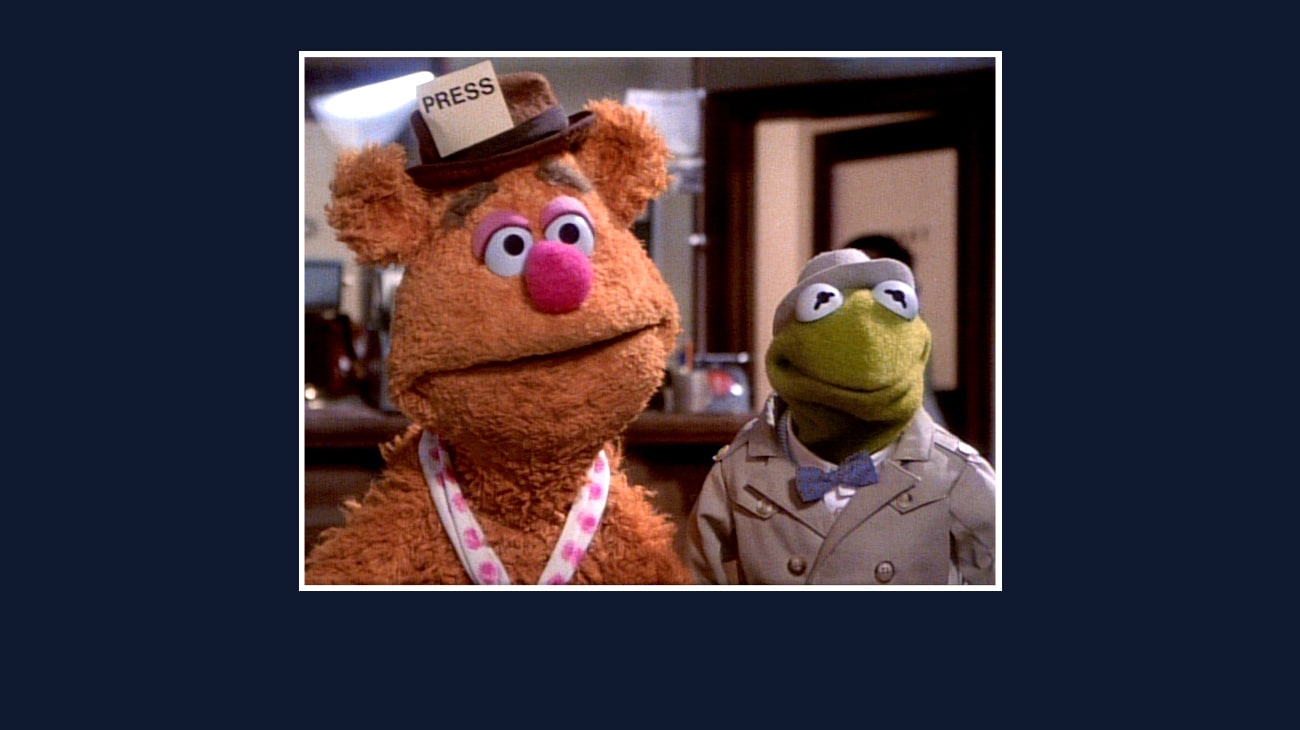 Fozzie and Kermit from the Disney movie The Great Muppet Caper.