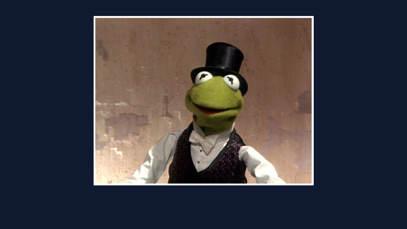 Kermit the Frog in a top hat from the Disney movie The Great Muppet Caper.