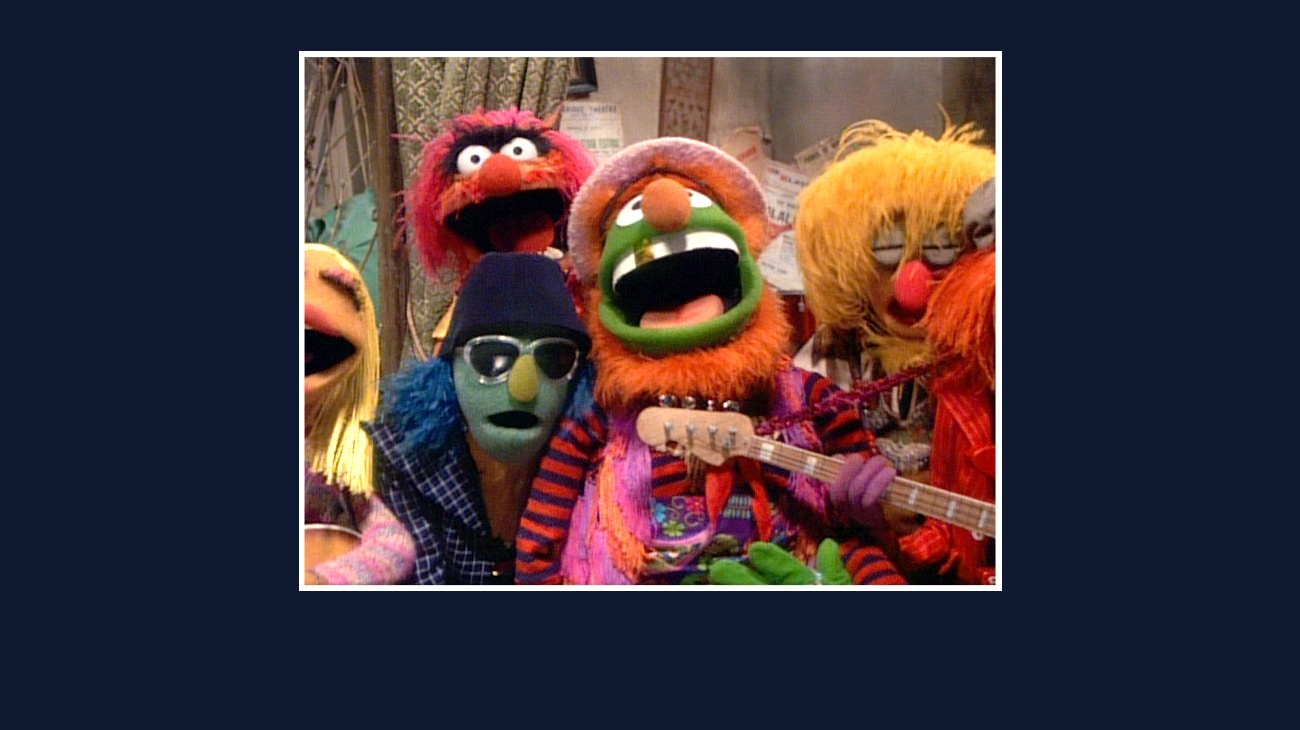 Dr. Teeth, Animal, Zoot, Janice, Lips, and Floyd Pepper from the Disney movie The Great Muppet Caper.