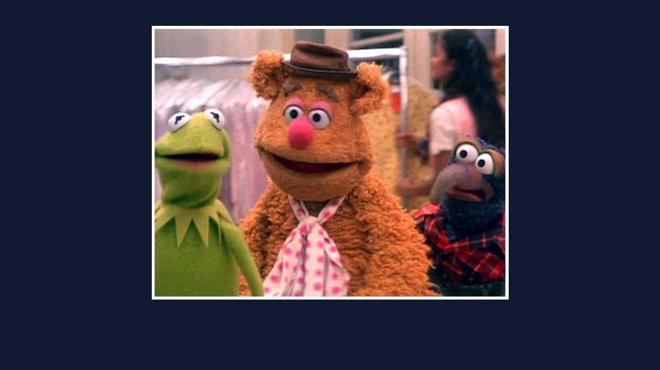 Kermit, Fozzie, and Gonzo from the Disney movie The Great Muppet Caper.