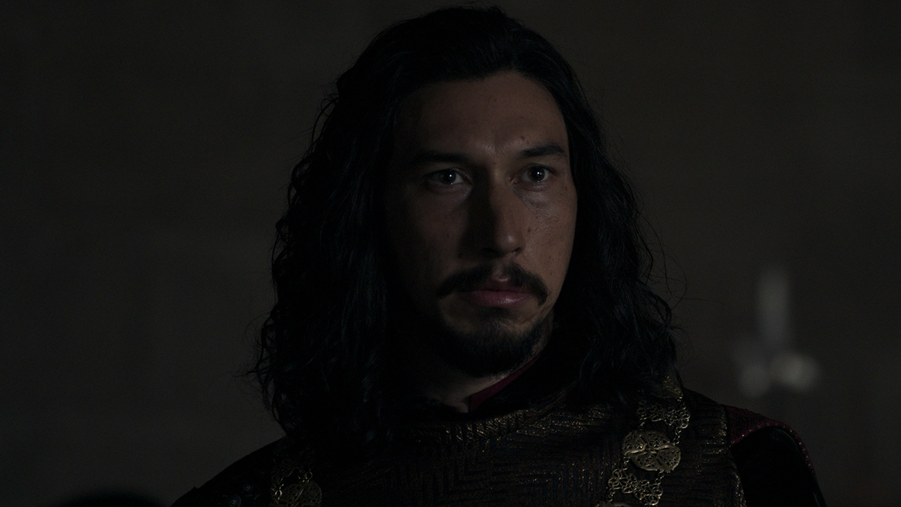 Jacques Le Gris (actor Adam Driver) staring into the distance from the 20th Century Studios move The Last Duel.