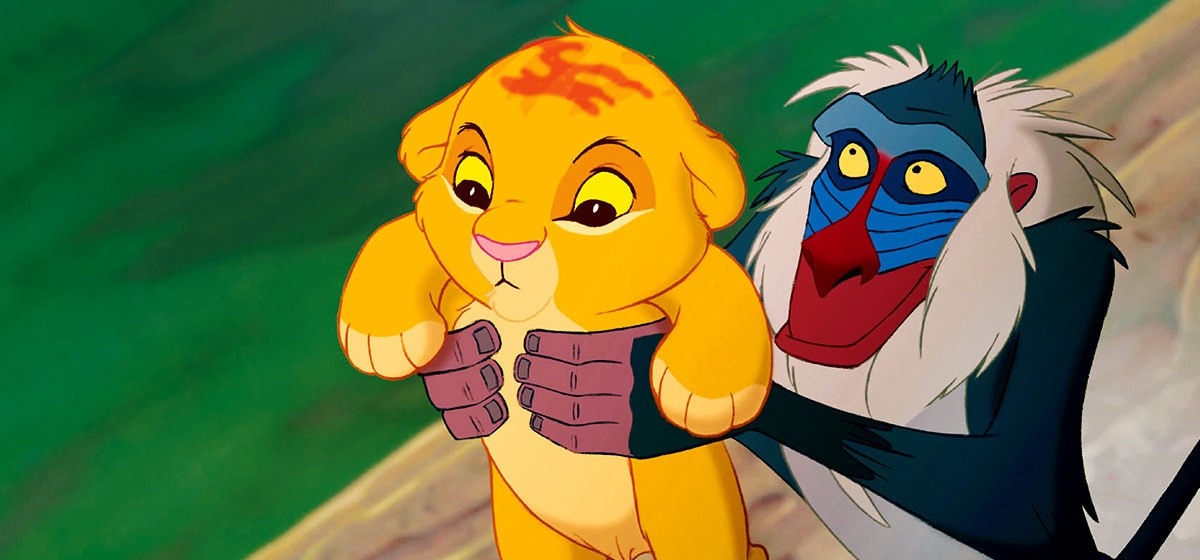 """Robert Guillaume (Rafiki) holds the new born baby (Simba) in """"The Lion King"""""""