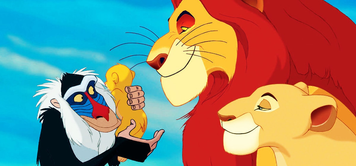 "James Earl Jones (Mufasa), Robert Guillaume(Rafaki) holding baby Simba, and Madge Sinclair (Sarabi) in ""The Lion King"""