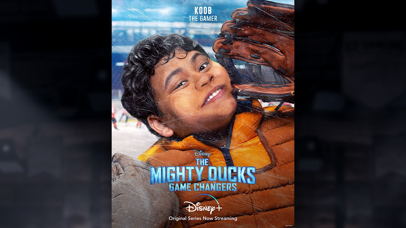 Koob | The Gamer | Image of Koob's face pressed against the hockey rink glass, from the Disney+ Original Series The Mighty Ducks: Game Changers.
