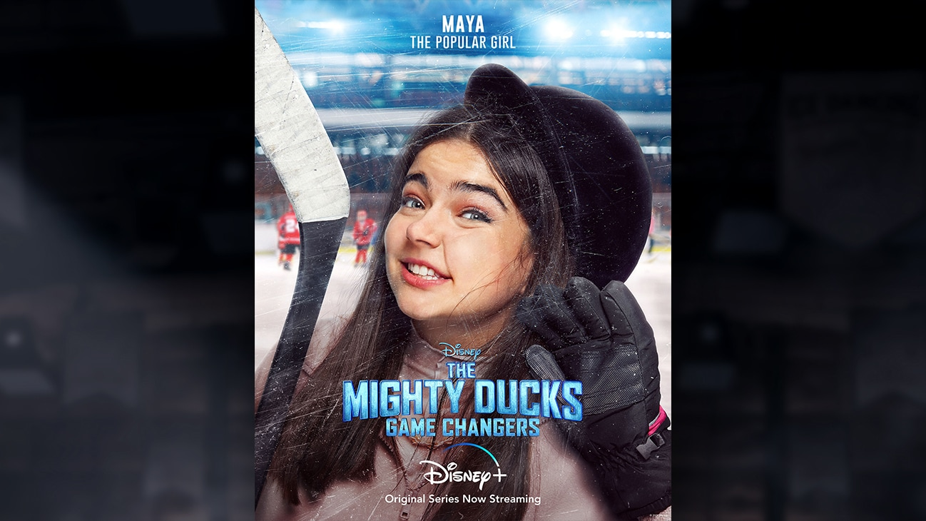Maya | The Popular Girl | Image of Maya's face pressed against the hockey rink glass, from the Disney+ Original Series The Mighty Ducks: Game Changers.