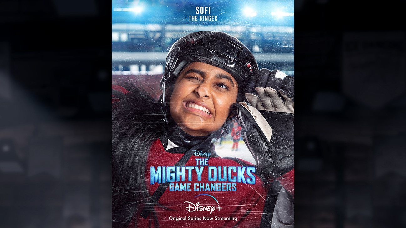 Sofi | The Ringer | Image of Sofi's face pressed against the hockey rink glass, from the Disney+ Original Series The Mighty Ducks: Game Changers.