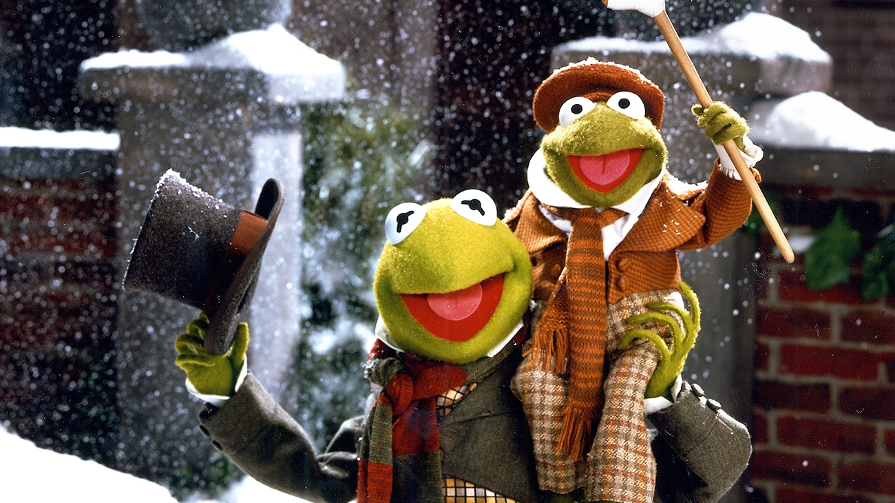 Kermit the Frog as Bob Cratchit (voice of Steve Whitmire) and Tiny Tim Cratchit (voice of Jerry Nelson) from the Disney movie The Muppet Christmas Carol.