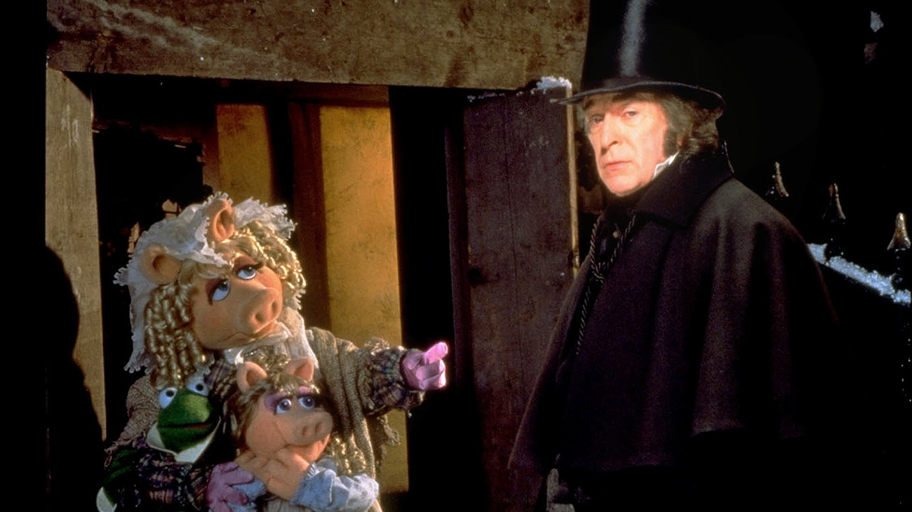 Ebenezer Scrooge (Michael Caine) and Miss Piggy as Emily Cratchit (voice of Frank Oz) from the Disney movie The Muppet Christmas Carol.