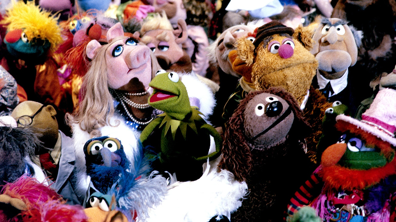 Several Muppets all gathered in a crowd