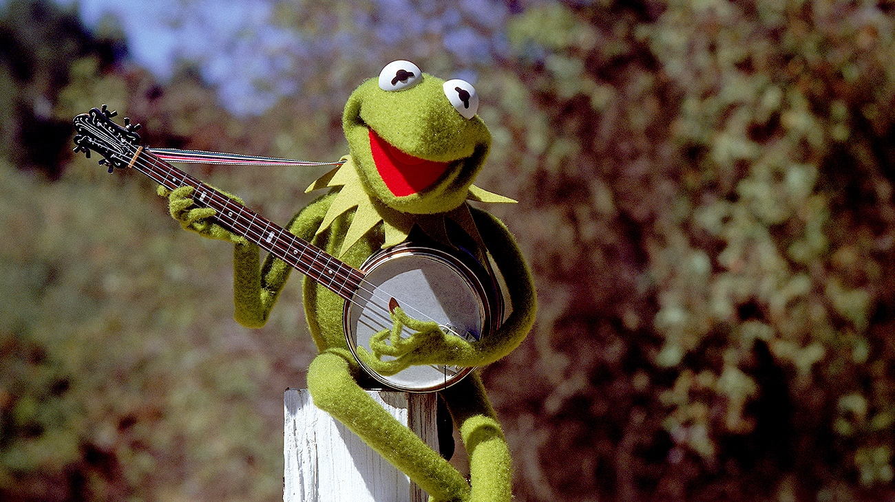 Kermit the Frog voiced by  playing a banjo in The Muppet Movie