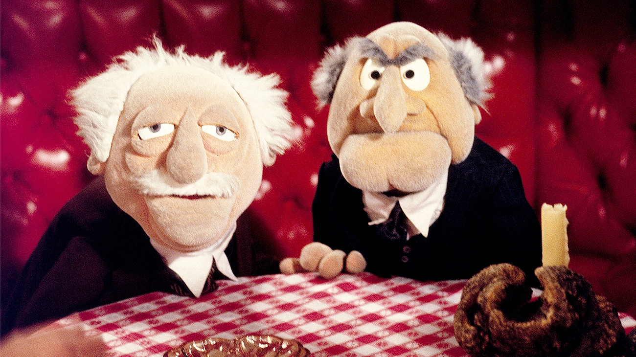 Statler and Waldorf at a table in The Muppet Movie