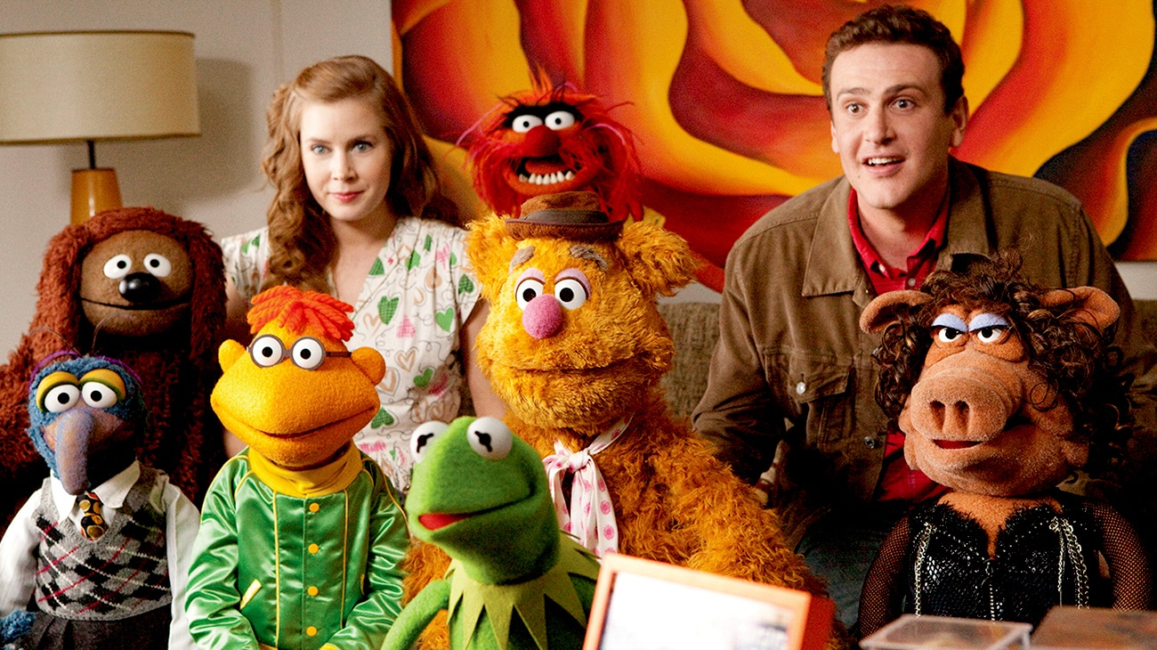 A group of muppets with Gry played by Jason Segel, look surprised