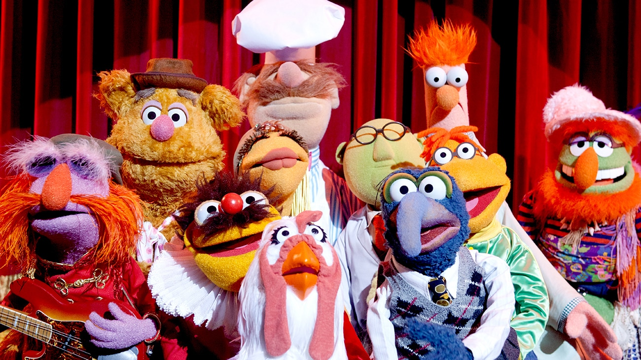 A group of muppets looking shocked