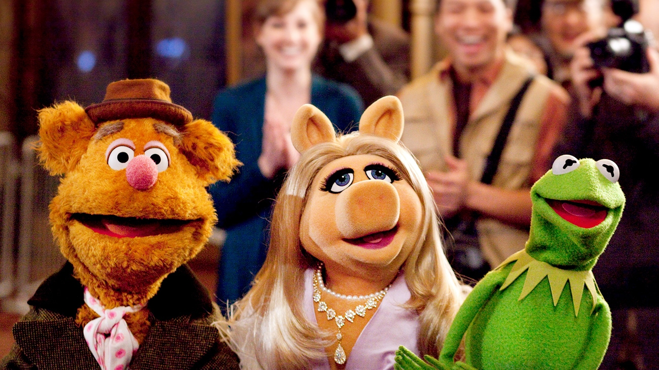 Fozzie the Bear Miss Piggy and Kermit the frog posing